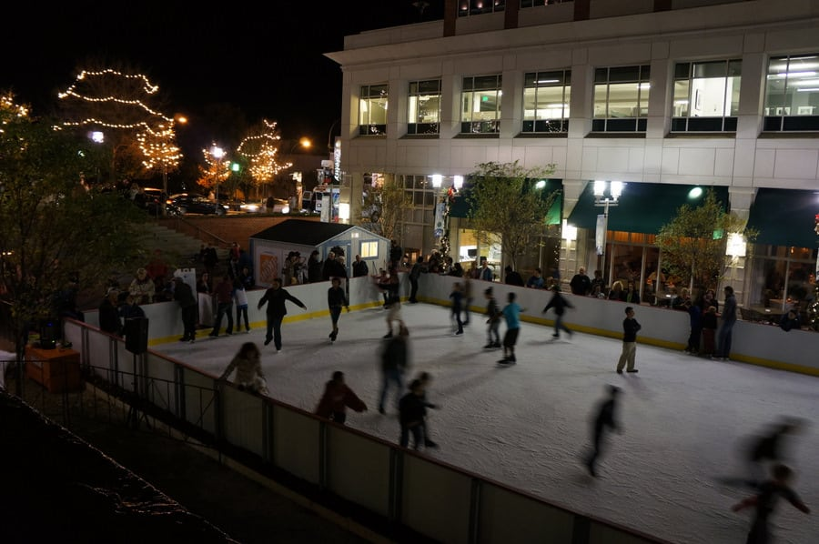 people ice skating on downtown marriot hotel ice rink