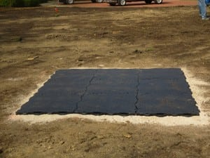 small square of ultrabasesystems panels laid out on gravel