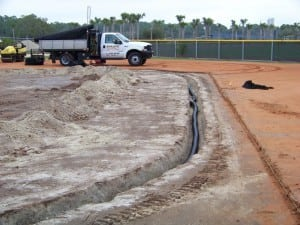 a trench for a drainage system for an artificial turf field installation