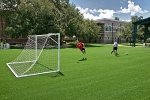 boys playing on tamp artificial turf soccer field