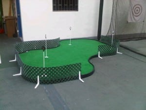 putting green with net in man cave