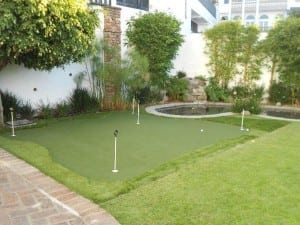 backyard putting green next to pond
