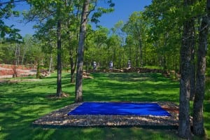 blue artificial putting turf installation for snag golf course