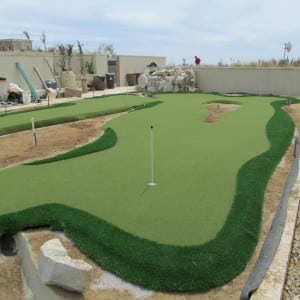 rooftop putting green installation almost complete