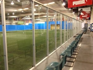 finished glass wall around indoor artificial soccer field
