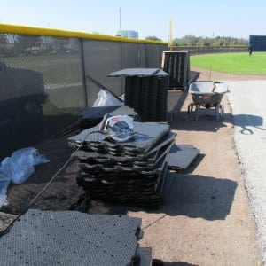 stacked ultrabasesystems panels ready to be laid out for baseball field turf installation