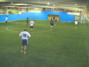 men playing soccer on new indoor artificial turf field