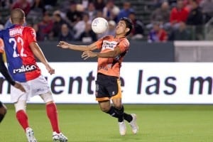 soccer ball approaches soccer player's face