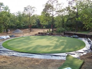 artificial turf installed on base panels for circular putting green